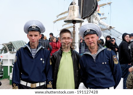 VARNA, BULGARIA - MAY 01, 2014: Varna is a host of the maritime event - SCF Black Sea Tall Ships Regatta. Russian sailors from tall ship Nadezhda are posing for pictures with visitors.