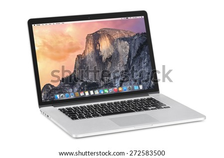 Varna, Bulgaria - November 03, 2013: Apple 15 inch MacBook Pro Retina with OS X Yosemite on the tilted back monitor. Isolated on white background. High quality. - stock photo