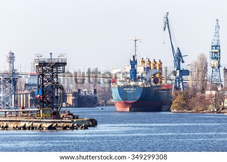 VARNA, BULGARIA - 21 November 2015: Black Sea port of Varna, the Black Sea. Large marine cranes are loaded cargo freight industrial marine vessel.