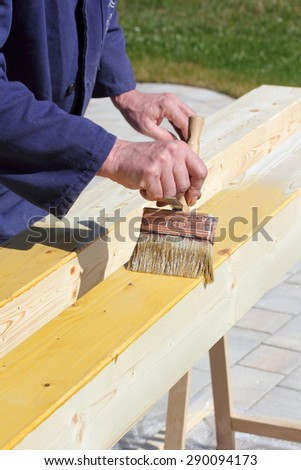 Varnishing of pine wooden beams
