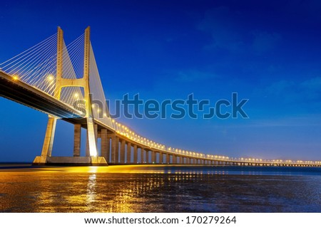 Vasco da Gama bridge is the largest in Europe over the Tagus river - stock photo