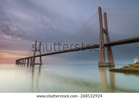 Vasco da Gama bridge over tagus river in Lisbon before sunrise - stock photo