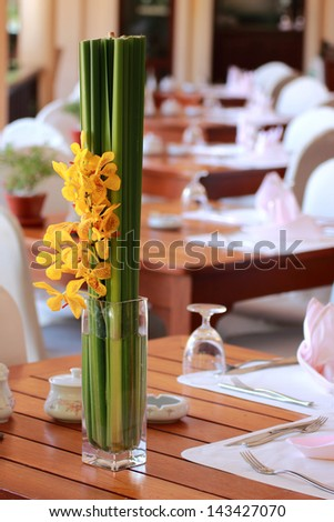 Vase of flowers at the restaurant - stock photo