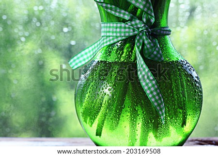vase of flowers on a green background summer
