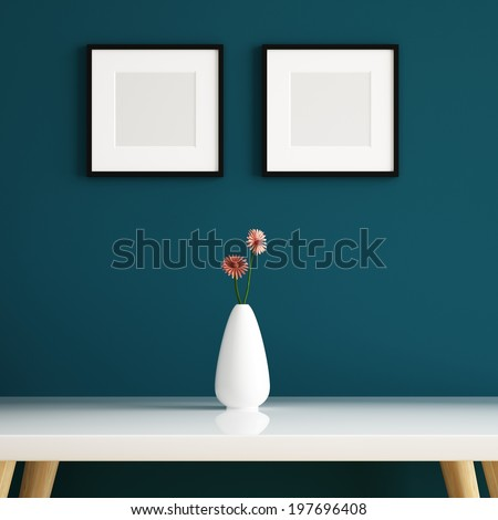 Vase on white table and picture frame decorated - stock photo