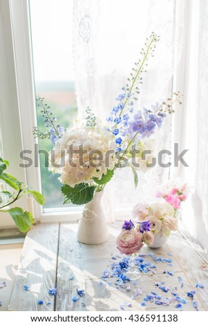 Vase with a delicate bouquet of pink roses - stock photo