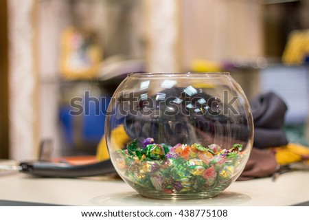 Vase with candy - stock photo