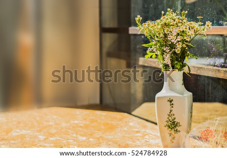 Vase with daisies background.