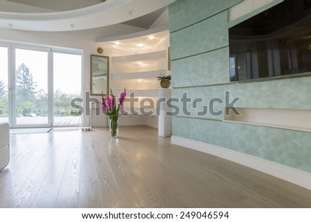 Vase with flowers in drawing room in pastel colors