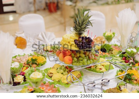 vase with fruits on restaurant's table - stock photo