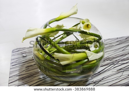 Vase with green flowers