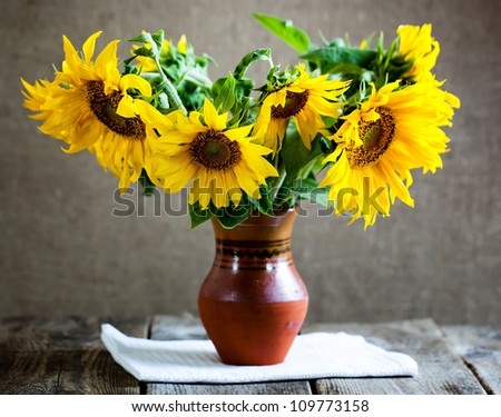 Vase with sunflowers - stock photo