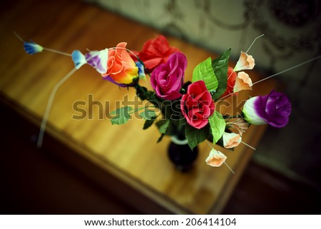 vase with the flowers on an old bedside table - stock photo