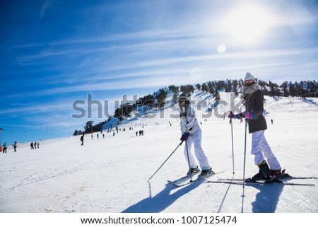 Vasilitsa, Greece - January 5, 2018: Skiers enjoy the snow at Ski Resort Vasilitsa in the mountain range of Pindos, in Greece. The ski resorts currently has 5 lifts and 16 ski trails