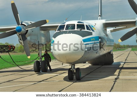 Vasilkov, Ukraine - April 24, 2012: Ukrainian Air Force An-26 cargo plane being prepared for the engine start