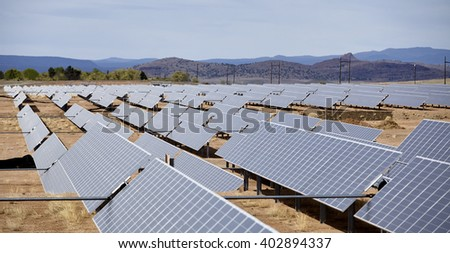 vast array of solar electric panel power utility industry grid on open countryside landscape