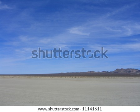 vast desert, cirrus clouds - stock photo