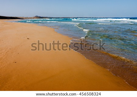 Vast empty beach Praia Grande, Cape Verde, Africa. Clean sand and calm waves - stock photo