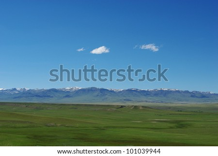 Vast plains and huge Absaroka Rockies, Shoshone National Forest, Wyoming - stock photo