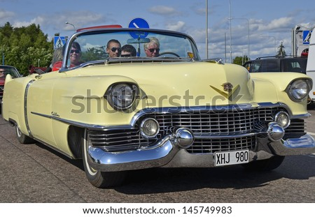 VASTERAS, SWEDEN - JULY 6: Unidentified people in power big meet cruising with old classic car. official name is power meet and organization are power big meet on July 6, 2013 in Vasteras Sweden