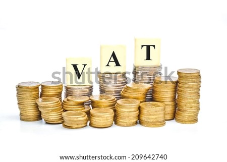 VAT (Value Added Tax) on Stacks of Gold Coins with isolated background - stock photo