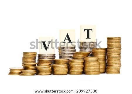 VAT (Value Added Tax) on Stacks of Gold Coins with isolated background