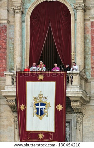 VATICAN - APRIL 19: Pope Benedict XVI (Joseph Ratzinger) on the balcony of Saint Peter's Basilica after he was elected by conclave as pope prays and blesses in Vatican city, Vatican on April 19, 2005. - stock photo