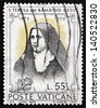 VATICAN - CIRCA 1973: a stamp printed in the Vatican shows St. Teresa of Lisieux and of the Infant Jesus, Carmelite Nun, circa 1973 - stock photo