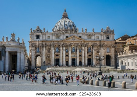 VATICAN CITY - AUGUST 8, 2016: St. Peter's square in front of St. Peter's Basilica - a grandiose elliptical esplanade created in the mid seventeenth century by Gian Lorenzo Bernini.