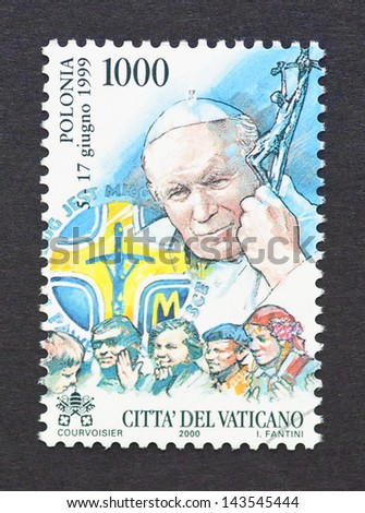 VATICAN CITY - CIRCA 2000: a postage stamp printed in Vatican City to commemorate pope John Paul II travel to Poland, circa 2000.