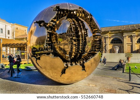 "VATICAN CITY - DECEMBER 28, 2016: Bronze sculpture ""Sphere within a Sphere"" (Sfera con sfera) by Italian sculptor Arnaldo Pomodoro at the Vatican museums."