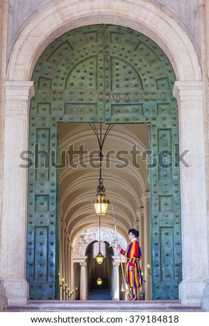 Vatican City, Italy - 23 August 2013: The Papal Basilica of St. Peter in the Vatican. The Pontifical Swiss Guard, is a small force responsible for the safety of the Pope. - stock photo