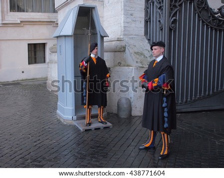 VATICAN CITY - JANUARY 02, 2016: Papal Swiss guards standing in traditional winter uniforms at St. Peter's basilica in Vatican. Swiss Guard has served and protected the popes and Vatican since 1506.
