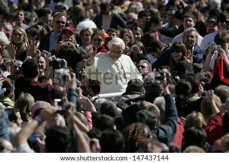 VATICAN CITY, VATICAN - APRIL 12 :  Pope Benedict XVI greets the pilgrims during his weekly general audience in St Peter's square at the Vatican on April 12, 2006 - stock photo