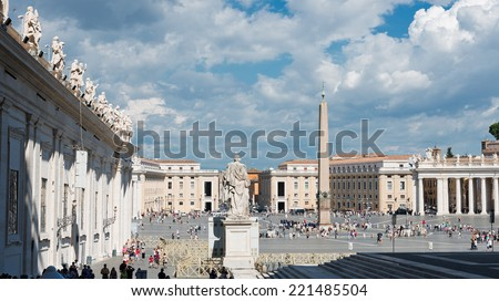 VATICAN CITY, VATICAN - JULY 15 2014: Tourists at Saint Peter's Square in Vatican City, Vatican. Saint Peter's Square is among most popular pilgrimage sites for Roman Catholics.  - stock photo
