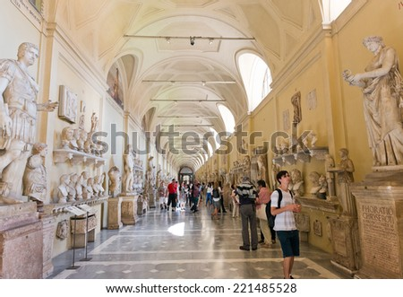 VATICAN CITY, VATICAN - JULY 15 2014: Visitors at the Vatican Museums in Rome Italy.It's includes some of most classical sculptures and important masterpieces of Renaissance art in the world. - stock photo