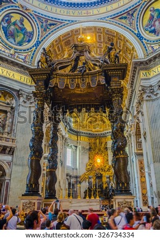 VATICAN, ITALY, JUNE 1, 2014: basilica of saint peter in vatican is seat of pope and its rich decorated interior every year attracts thousands of tourists and believers.