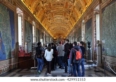 VATICAN, ITALY - MARCH 14, 2016: Tourists visiting the famous Gallery of Maps in the Vatican Museum, one of the major tourist attraction of the Vatican Museums