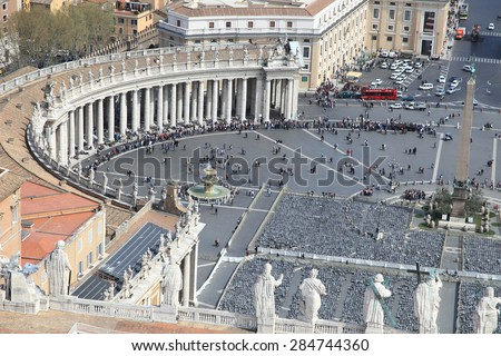 VATICAN - MARCH 31, 2010: Saint Peter's Square on March 31, 2010 in Vatican.  It is one of the most visited landmark market squares in Europe. - stock photo