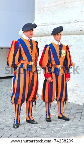 VATICAN - MAY 18: Famous Swiss Guard on May 18, 2010 in Vatican. The Papal Guard - the world's smallest army.