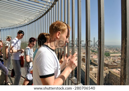 VATICAN - MAY 07: Tourists on the top of the St. Peter's Cathedral during a hot day in Vatican on May 07. 2015 in Italy - stock photo