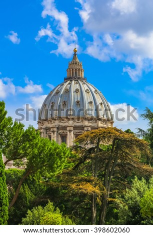 Vatican Palace is seen above the treetops - stock photo