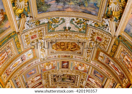VATICAN, VATICAN CITY - MAY 7, 2016: Paintings on the walls and the ceiling  in the Gallery of Maps, at the Vatican Museum. It was established in 1506
