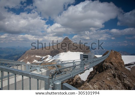 Vaud,Switzerland - July 11,2015: Peak Walk bridge.Peak Walk is a pedestrian suspension bridge linking two mountain peaks in the Swiss Alps