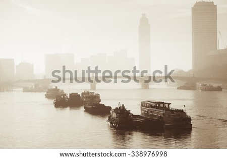 Vauxhall Bridge in fog seen from Lambeth Bridge  - stock photo