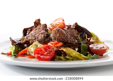 Veal and Mushrooms Salad with Mixed Salad Leaves and Cherry Tomato - stock photo