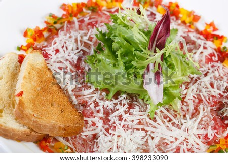 veal carpaccio with toast on a plate - stock photo