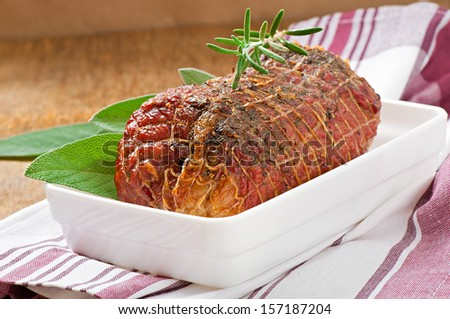 veal roll filled with minced beef meat and herbs - stock photo