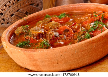 Veal stew with tomatoes and herbs - stock photo