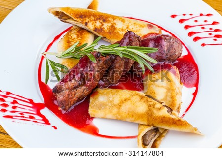 Veal tenderloin and pancakes with mushrooms